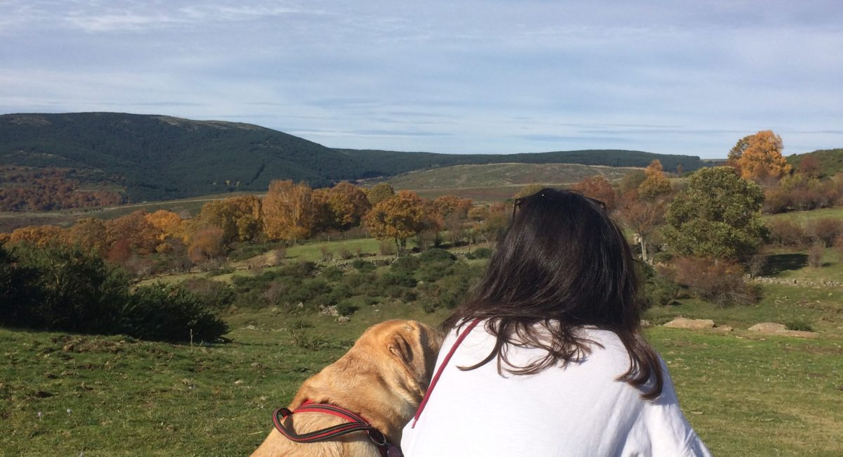 claudia and her dog in the countryside