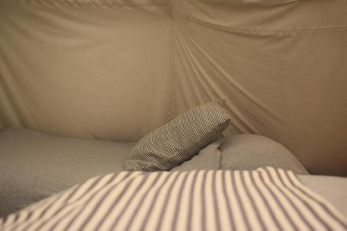 Large Tipi - inside. King size bed, 3 singles.