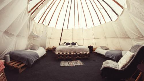 Large Tipi - inside. King size bed and 3 singles.